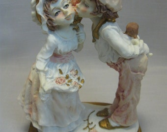 Figurine Statue Boy Kissing Girl Wood Base White Pinks & Gold Decor SeeMe UOGC 1990