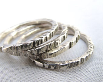 Four Sterling Silver Hammered Distressed Stack Rings