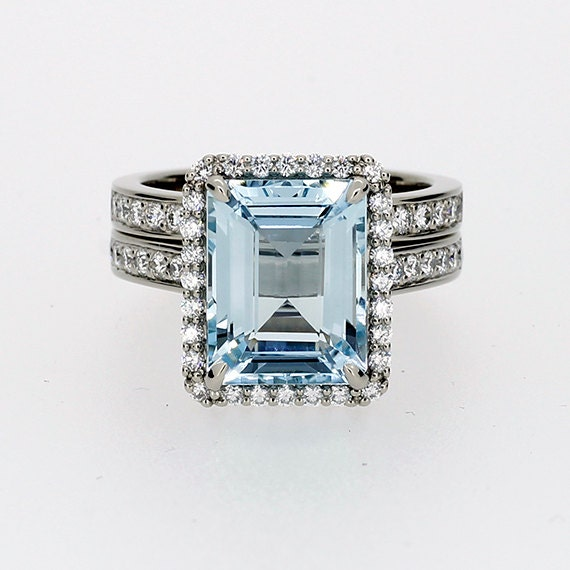 emerald cut aquamarine halo engagement ring by