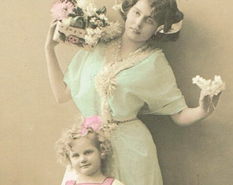 Antique Edwardian, 1900s, coloured / coloured sepia postcard, pretty Edwardian lady and child - unused