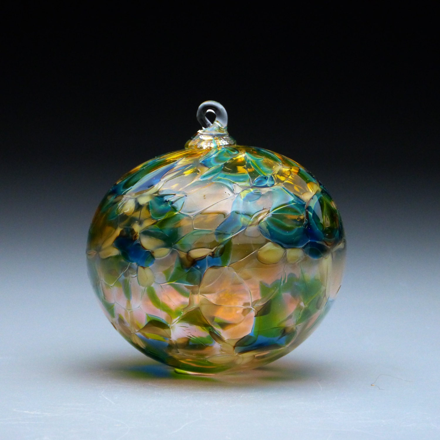 Hand made blown glass christmas ornament in tones of gold