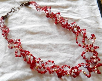 crocheted beaded necklace reds and ivories. made in Ireland