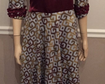 Beautiful 70's maxi dress with Ruffles and tie back at waist. Half sleeves . Size Medium / Large
