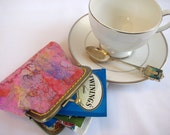 Wet Felted wool tea wallet with silk threads, and silk fibers. Peach, purple, pink. lined. Exquisite!