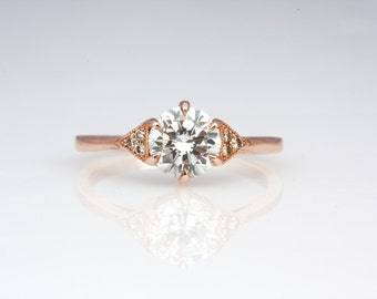 June Ring in 14kt rose gold with 6.5mm moissanite and champagne diamonds