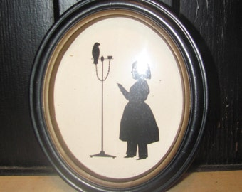 Vintage Silhouette of Child and Pet Parrot/Bird
