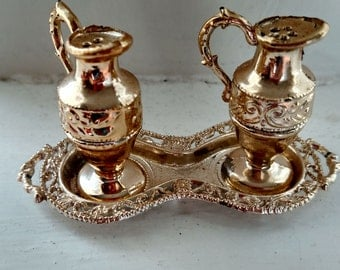 Vintage water pitcher salt and pepper shakers on a tray