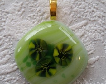 Green fused glass pendant with yellow and green murini