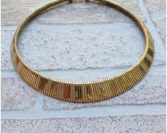 Wide gold tone circular necklace