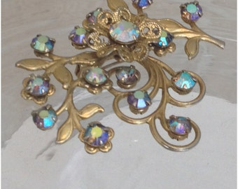 Gold tone blue stone floral brooch
