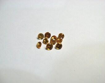 Spessartite Garnet 3mm round faceted gems.  10 pieces per lot.