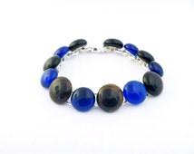 Recycled wine bottle link bracelet handmade from blue and brown upcycled glass