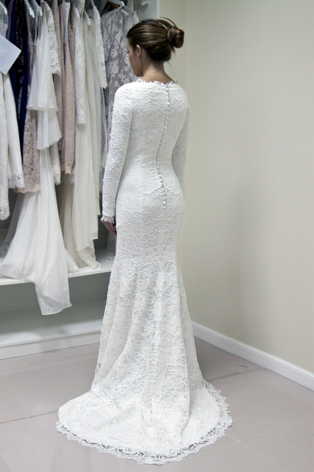 French lace wedding gown with lined sleeves and scalloped for Skin tight wedding dresses