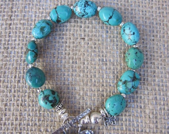 GENUINE TUQUOISE BRACELET with Sterling Silver  Butterfly Toggle Clasp, Charm and barrel beads