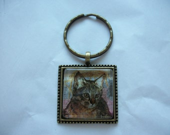 A Postage Stamp Keychain from Ras-al-Khaimah of a Cat. Antique Brass.One of a kind. Hand made.