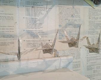 5 Origami Kraniche aus Textseiten
