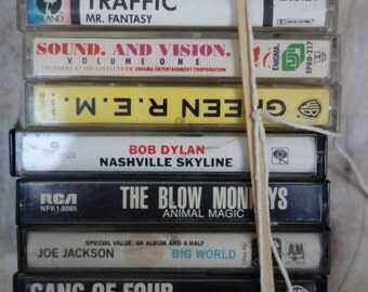 one lot of EIGHT rock cassettes