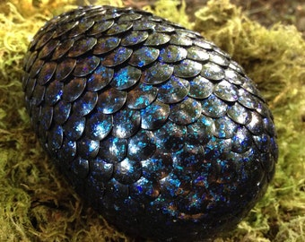 Black dragon egg with blue glitter