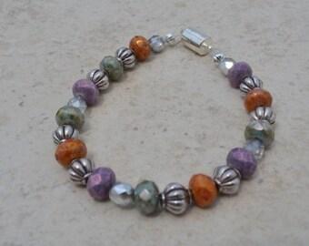 Handmade bracelet with orange , purple , geeen and silver beads