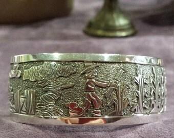 Sterling silver story teller cuff bracelet