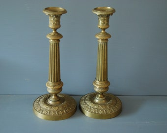 Two French antique gilded bronze candlesticks circa 1850, Style Empire,  with embossed details, grapes, vine leaves.