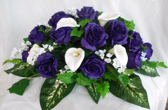 Royal purple and white calla lilies , roses and lily of the Valley bridal table centerpieces