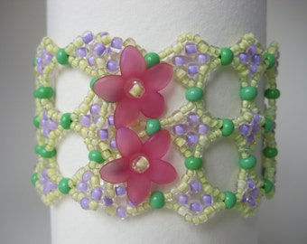 Summery beadwork cuff bracelet in yellow, green, purple and pink