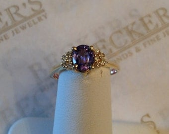 Beautiful vintage 14k yellow gold Oval Tanzanite and 10 Diamond Ring, .65 ctw