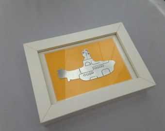 Yellow, Submarine picture - inspired by The Yellow Submarine - hand-cut from recycled aluminium, polished and mounted on bright yellow card