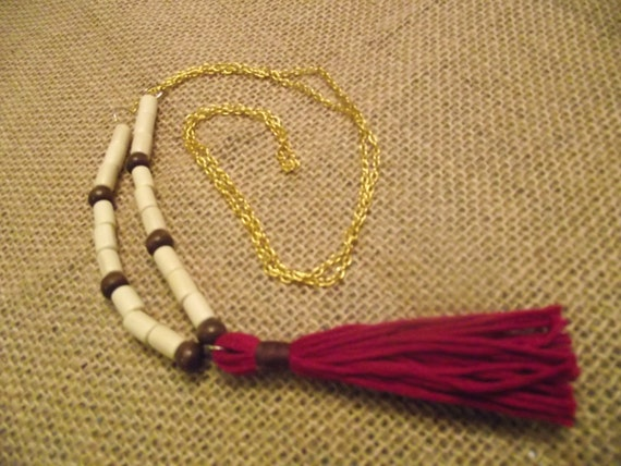 Necklace with wine colored tassel