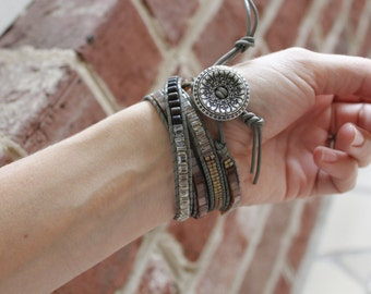 Beaded wrap bracelet with engraved button