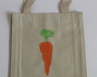 Carrot Tote - A natural canvas tote with a bright orange carrot with a green leafy top. Acrylic