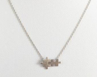 Silver puzzle necklace...dainty, simple and fun