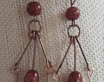Copper wire wrapped earrings with earth tone beads.