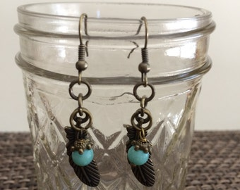 Antique bronze feather and Aqua glass 6 mm earrings