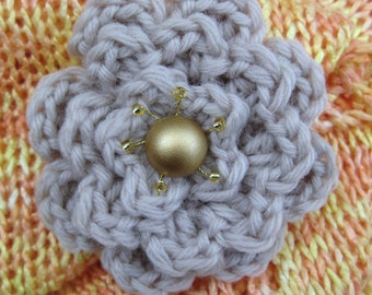 Handmade crocheted brooch with golden colour button and beads.