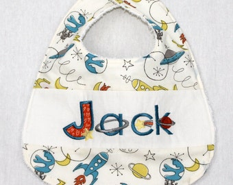 Custom Bib with baby name in Space fabric by Monaluna for Birch