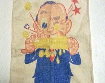 Antique 1930's baby boy bib featuring a cartoon character of a man eating corn on the cob  real vintage