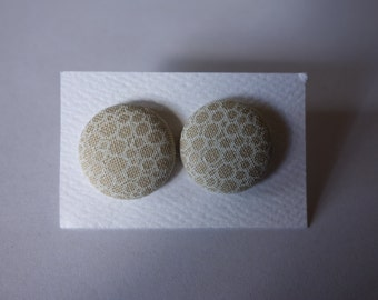 handmade beige bubble print fabric button earrings. Hypo-allergenic nickel-free silver studs