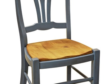 Dining chair with reclaimed barnwood seat.