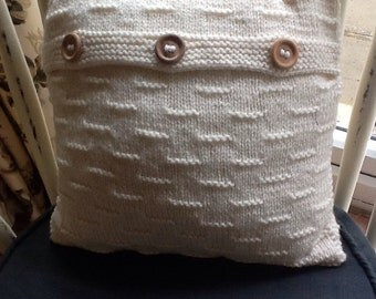 Cream, knitted cushion cover including pad