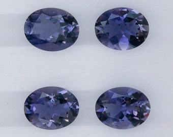 Iolite 9x7 mm faceted ovals .  4 pieces per lot and top grade