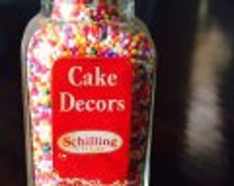Vintage 2 oz Schilling Cake Deco Glass bottle with Deco inside