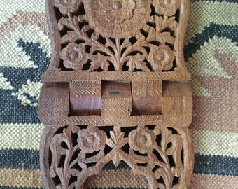 A beautiful hand carved wood book holder display