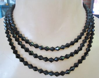 Long Thin Strand of Black Glass Beads