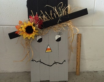 Wooden Scarecrow with Fall Leaves