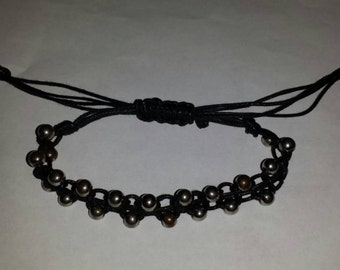Black knotted cord with silver beads