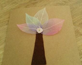 Hand stitched felt and leaf skeleton greetings card