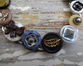 Button and watch part bracelet/mixed metals