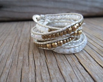 Gorgeous leather wrap, in white and tan, with white and gold crystals